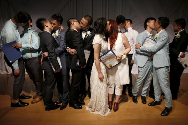 Couples kiss after getting married at a group wedding for seven same-sex couples from China, in West Hollywood, California